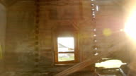 ray of sunshine in the old destroyed wooden church video