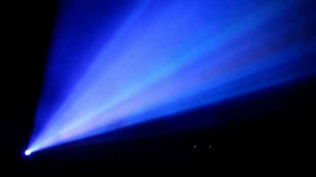 rays of color light from video projector video