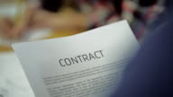 read Business Contract, Mutual Agreement, in blurring the background is the same Signing video