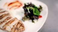 Read the close-up of chicken steak with salad. video
