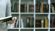 HD: Reading A Book At The Bookshelf video