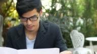 Reading Newspaper, 4K(UHD) video