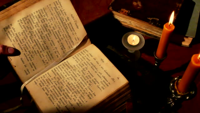 Reading Old Book Under Candlelight video