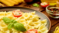 Ready to eat farfalle with cut tomatoes and basil video
