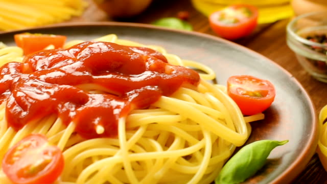 Ready to eat spaghetti with ketchup, tomatoes and basil video