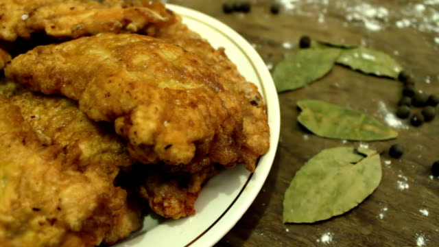 Ready-fried chicken nuggets on a plate video