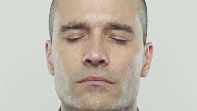 Real caucasian adult man closing eyes video