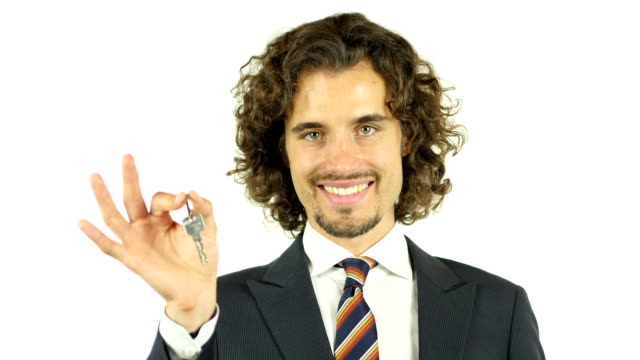 Real estate agent  giving keys  client video
