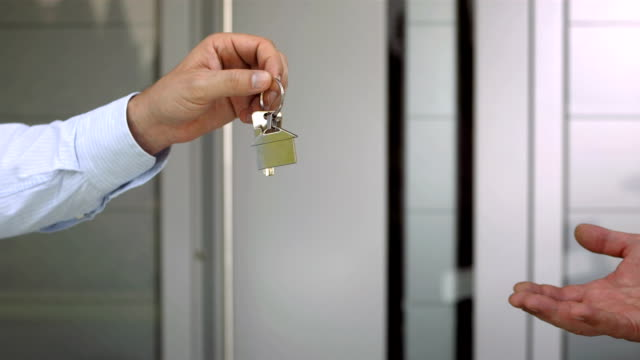 HD: Real Estate Agent Handing Keys video