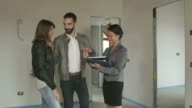 Real Estate Agent Saleswoman With Clients Customers Buying New House video