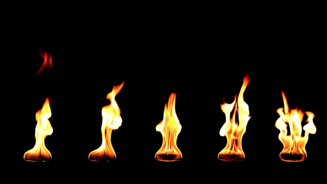 Real fire slow motion isolated on black background video