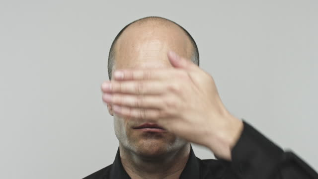 Real hispanic man gesturing see no evil video