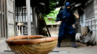 Real ninja in historical Japanese village running and hiding to attack enemies video