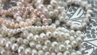 Real pearl jewelry on silver plate turning slowly video