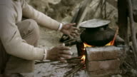 Real people from rural India: Man cooking food on bonfire video