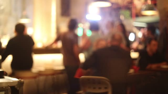 Real people having good time in the pub at night. video