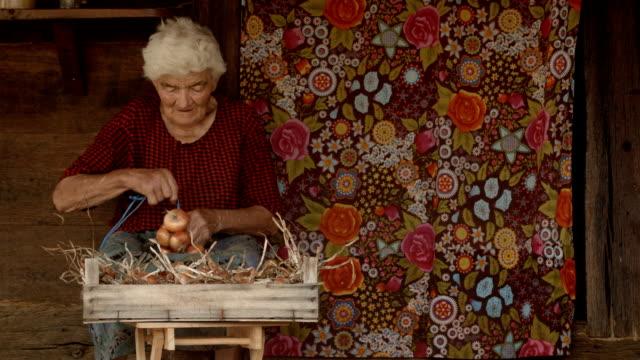 Real People-Senior Woman.Close-up shot of a Senior Woman While Preparing Food. Rural Scene. video