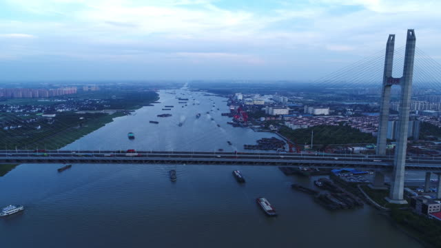 Real Time Aerial view of cars on mingpu bridge over river video