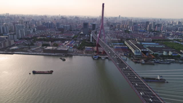 Real Time Aerial view of cars on yangpu bridge over river video