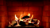 Real Wood Fire Burning in a Clean Brick Fireplace video
