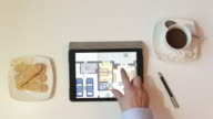 Real-estate agent showing house plans on electronic tablet video