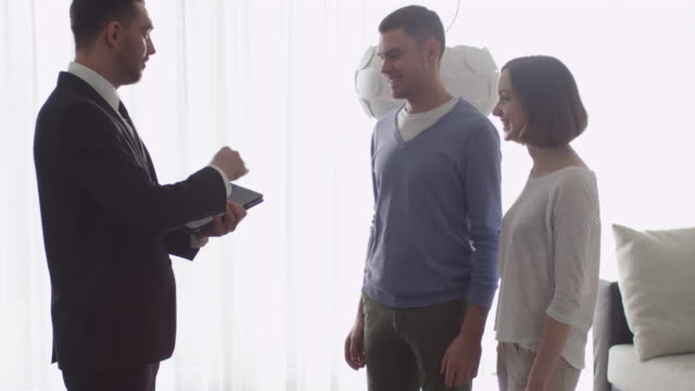 Real-estate Agent Shows New Apartments to Couple. video