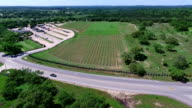 Really High angle Overlook to close to crops Aerial Wine to Market or Farm to Market in Austin Texas video