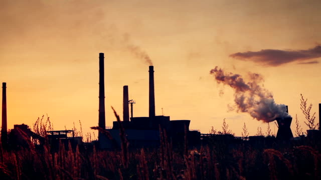 Real-time footage of a chemical factory at sunset video