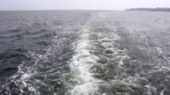 Rear view at swirling waters of the motor boat video