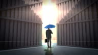 rear view of businessman holding umbrella video