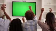 Rear View Of Family Watching Green Screen TV Shot On R3D video