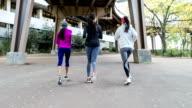 Rear view of three women running in New York video