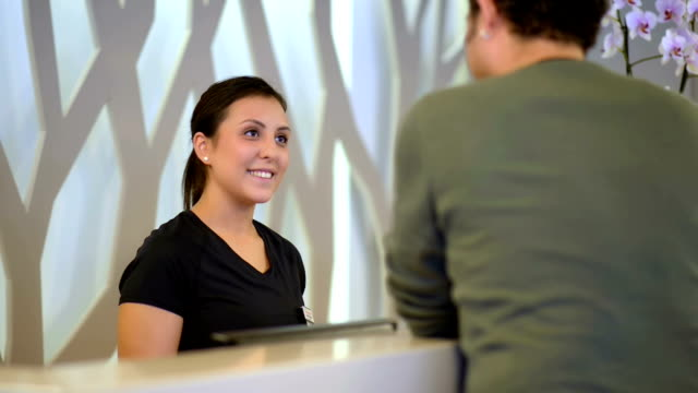 DOLLY: Receptionist sports club welcomes new customer video