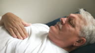 reclining man with chest pain video