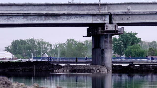 Reconstruction of a bridge over river. Timelapse. video