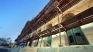 Reconstruction of old building with scaffolding video