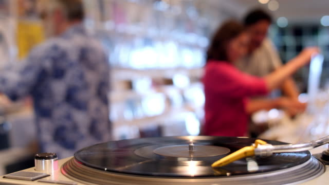 4K: Record player turning in music store video
