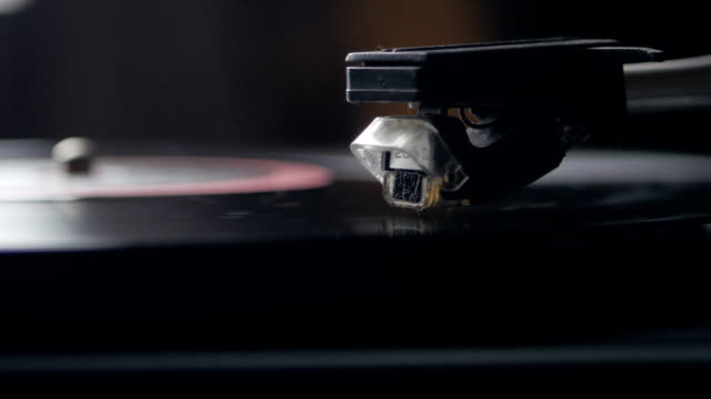 Record player turntable. A record player turntable with it's stylus running along a vinyl record video