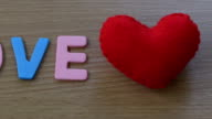 Recording a video move from left to right show a Text Love and Heart shaped red. video