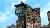 Rectangular lantern with broken glass on the background of blue sky video