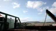 Recycling skip crane shot rising to blue sky video