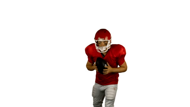 Red american football player send the ball video