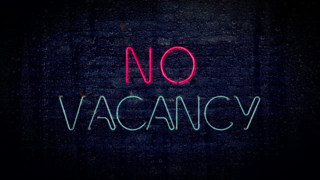 Red and blue no vacancy flashing neon sign video