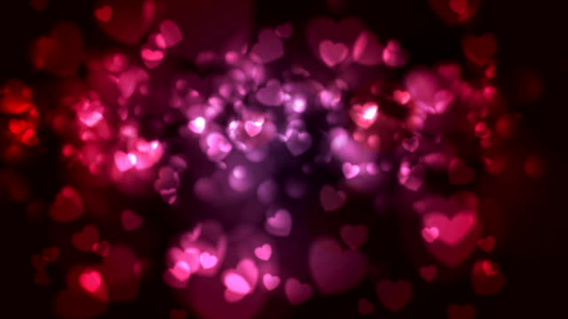 Red and pink glowing bokeh hearts video animation video