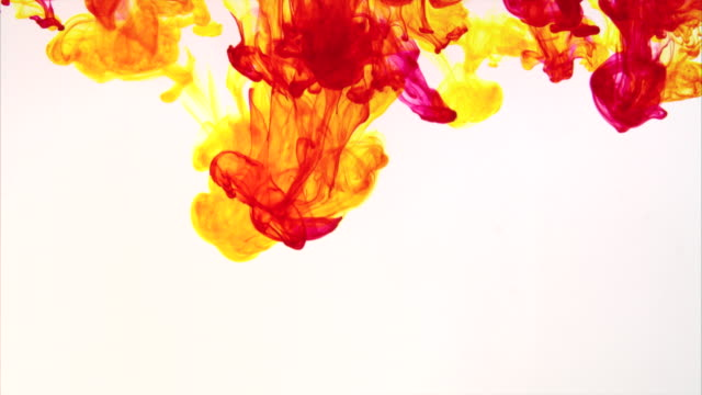 Red and yellow mixture of colors on white background video