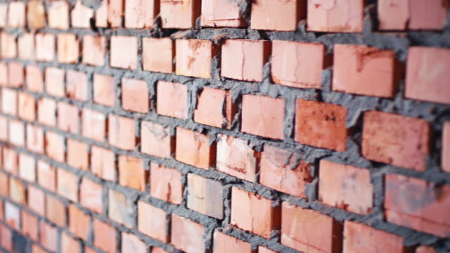 Red brick stack near wall video