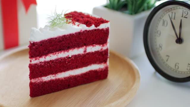 Red cake Strawberries cream cake on wooden dish on white table , dolly shot tilt up video