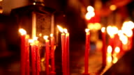 Red candles in church video