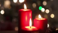Red candles with burning candles. video