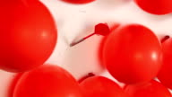 Red carnival balloons video